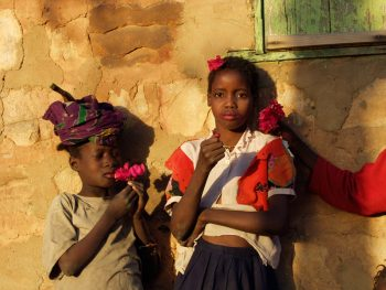 MALI. Segue-les-Pierres. Young girls use flower petals as make-up. 2002.