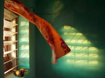 MALI. Segue-les-Pierres. At sunset, wind blows in a curtain. 2002.