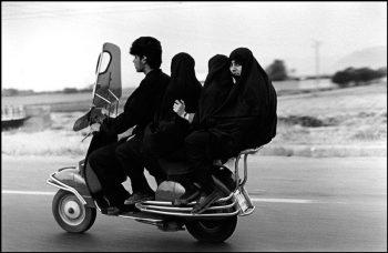 IRAN. Shahr Rey. 1997. Four seater motorbike.
